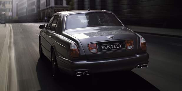 Rear view of a chrome Bentley Arnage T  driving through the city | Bentley Motors