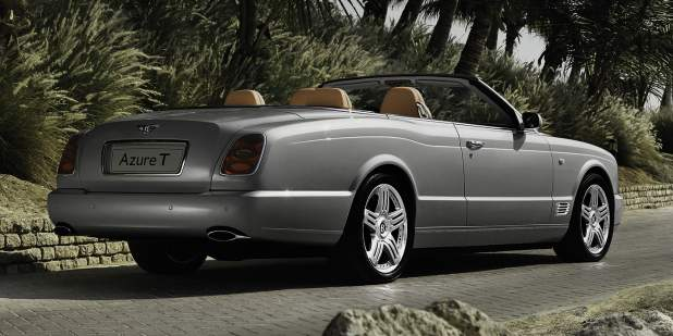 Silver Bentley Azure T Convertible parked at a tropical location | Bentley Motors