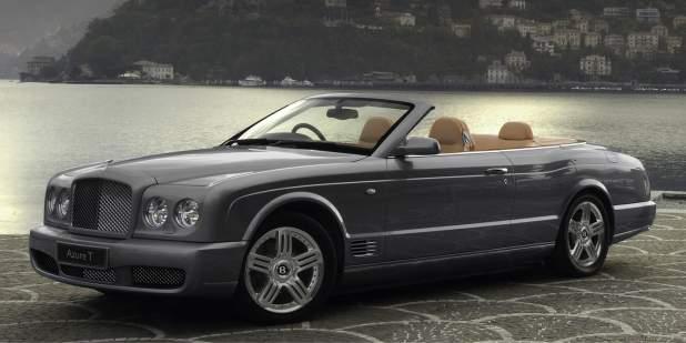 A dark grey Bentley Azure T Convertible parked next to a lake   Bentley Motors