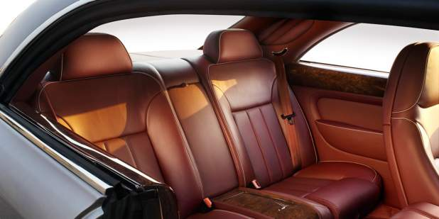 Rear cabin of a Bentley Brooklands luxury saloon with tan leather seats | Bentley Motors