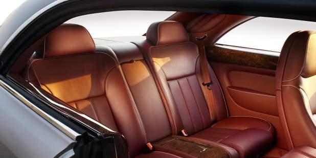 Rear cabin of a Bentley Brooklands luxury saloon with tan leather seats | Bentley Motors