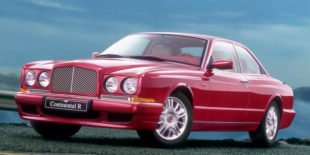 Front and side view of red Bentley Continental R on a mountain road   Bentley Motors
