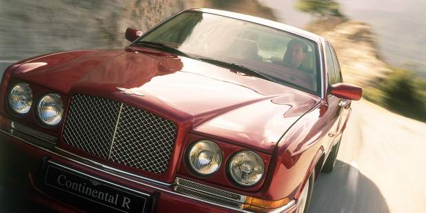 Front exterior view of a burgundy Bentley Continental R on a mountain road   Bentley Motors