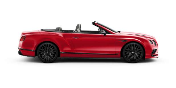 Side view of a red Bentley Continental GT Supersports Convertible with lowered roof | Bentley Motors