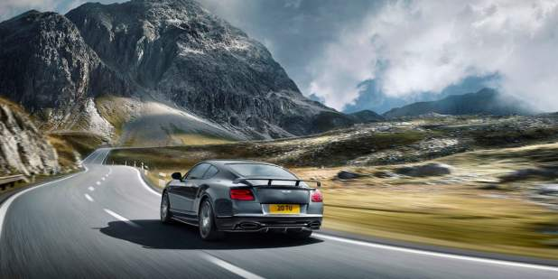 Rear view of a dark grey Bentley Continental Supersports on a mountain road | Bentley Motors