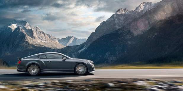 Dark grey Bentley Continental Supersports driving on a mountain road | Bentley Motors