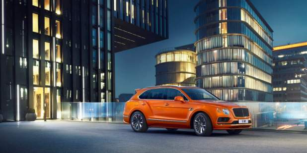 bentayga-speed-outside-city-building-at-night