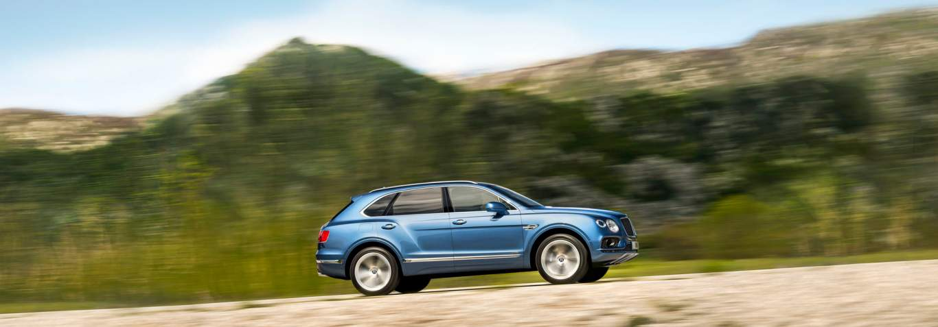 The Bentley Bentayga Sel Suv Driving Up A Mountain Road Motors