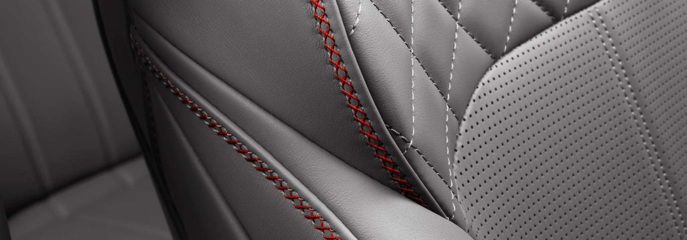 Bentayga V8 interior seat cross stitching detail in Pillar Box red with Porpoise leather