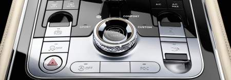 New Bentley Continental GT detail of front centre console showing driver controls and diamond knurled button