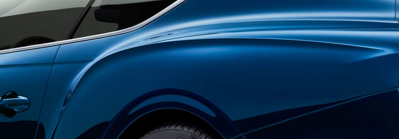new bentley continental gt detail of sculptural lines on side and haunch of car