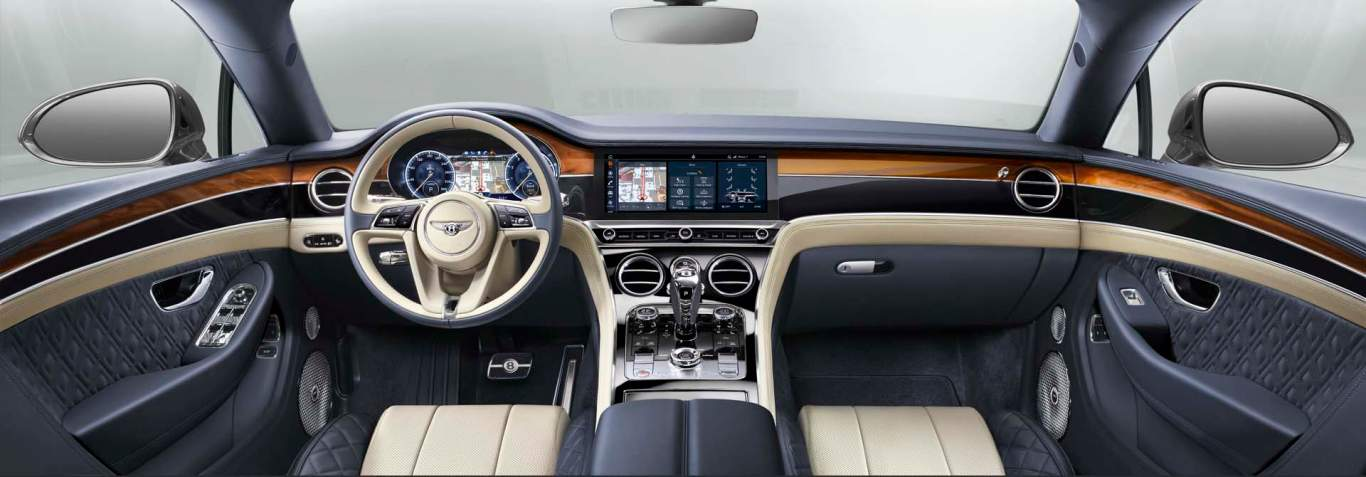 New Bentley Continental GT 2017 front interior showing front dash and side doors in matching dual veneer