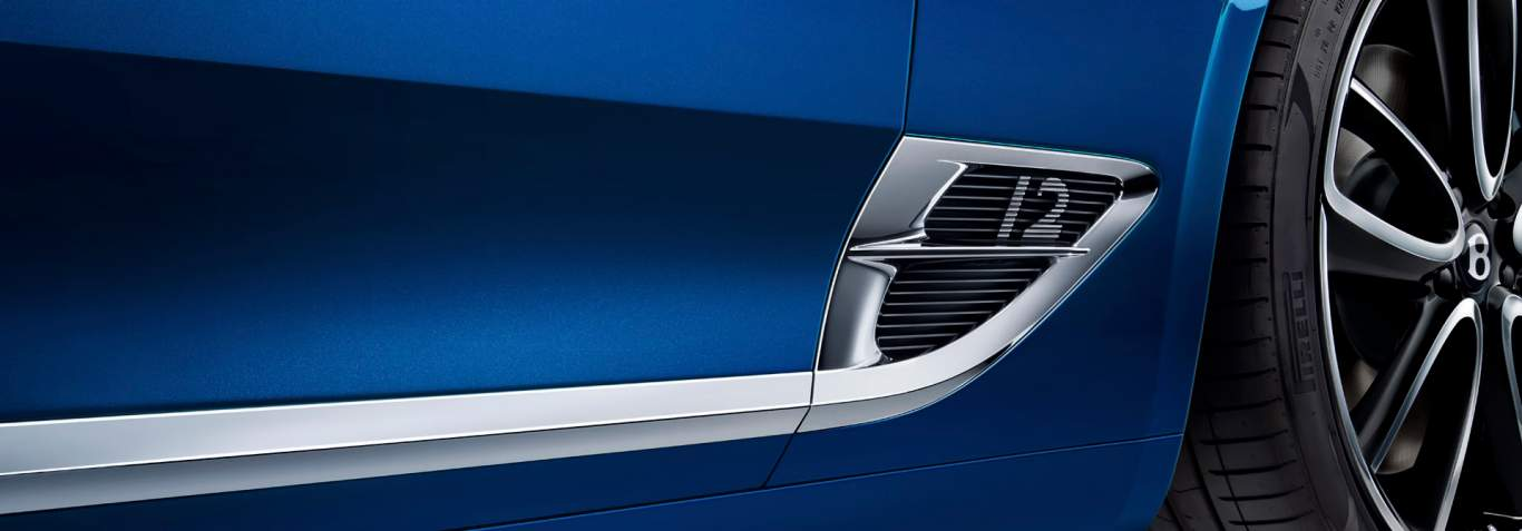 New Bentley Continental GT close up of side of car showing B shaped vent and wheel