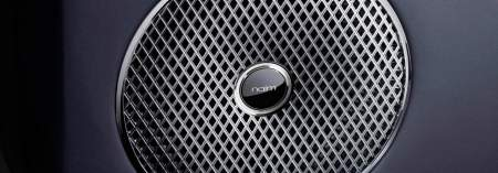 Naim speaker grille detail surrounded by blue grey leather on Bentley Continental GT 2017