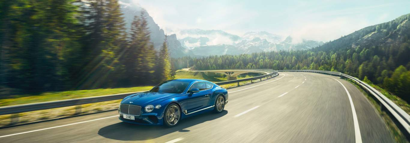 New Continental GT In Sequin Blue Driving On A Mountain Road In The  Dolomites, Italy