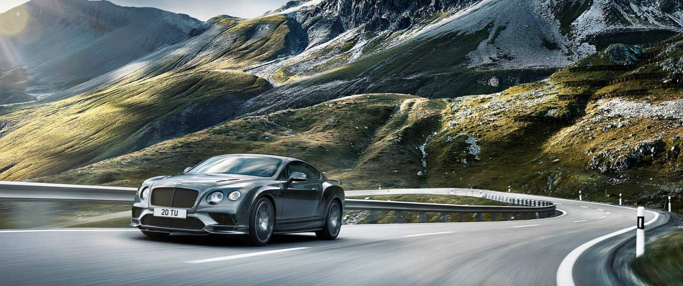 A Grey Bentley Continental Supersports Driving On A Mountain Road | Bentley  Motors