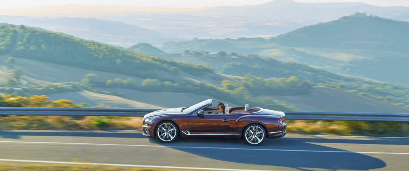 b4df67449a new-red-Bentley-Continental-GT-Convertible-driving-in-