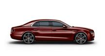 Side view of a dark red Bentley Flying Spur V8 S | Bentley Motors