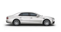 Side view of an ice white Bentley Flying Spur with silver wheel rims | Bentley Motors