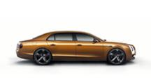 Side view of an orange Bentley Flying Spur W12 S | Bentley Motors