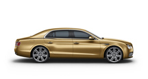 Side view of a gold Bentley Flying Spur W12 | Bentley Motors