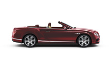 Side profile of a red Bentley Continental GT V8 Convertible with lowered roof | Bentley Motors