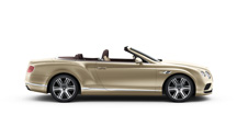 Side view of a bronze Bentley Continental GT Convertible with the roof down | Bentley Motors