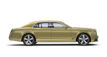 Side view of a gold Bentley Mulsanne Speed with silver wheel rims | Bentley Motors