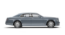 Side view of a grey blue Bentley Mulsanne sedan with silver wheel rims | Bentley Motors