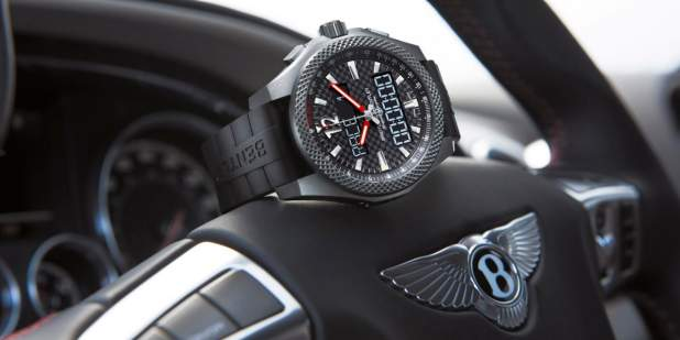 Breitling's Bentley Supersports B55 wristwatch, positioned on top of a Bentley steering wheel | Bentley Motors