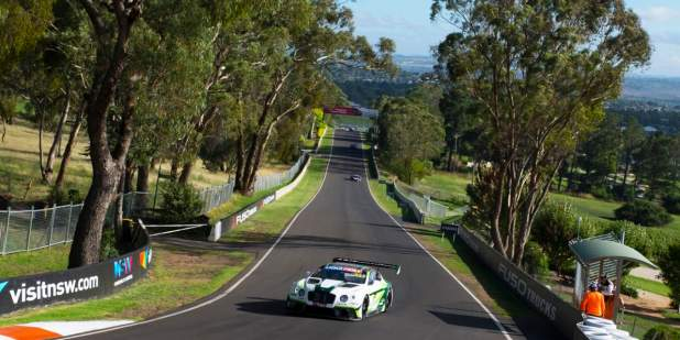 Distant view of a Bentley Motorsport Continental GT3 on on the race track at Bathurst, Australia | Bentley Motors