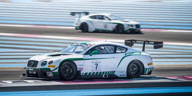 Side view of a Bentley Motorsport Continental GT3 driving on a race track | Bentley Motors