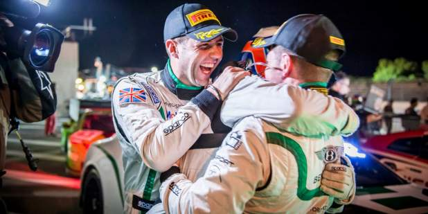 Smith, Meyrick and Kane hugging in celebration of their 2nd place win | Bentley Motors