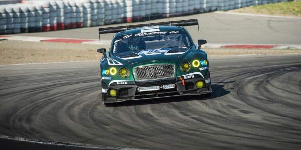 Front view of an emerald green Bentley Continental GT3 at Nürburgring race track | Bentley Motors