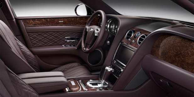 Damson purple leather and veneer finish front cabin of a Bentley Flying Spur Serenity | Bentley Motors