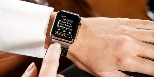 Woman controlling car settings using the Bentley app on an Apple iWatch | Bentley Motors