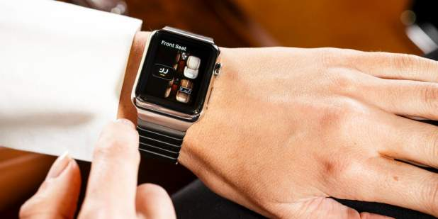 Woman controlling seat functions using the Bentley app on an Apple iWatch | Bentley Motors