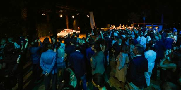 Dubai launch with guests gathered around car 2 1398x699.jpg