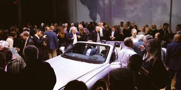 London launch party with guests around cars 1398x699.jpg