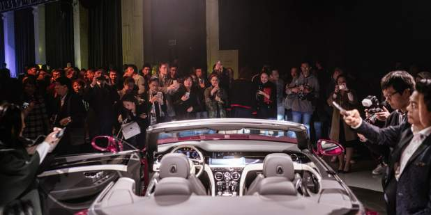 Shanghai launch with guests gathered around continental convertible car 1398x699.jpg