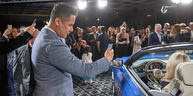 Sydney launch with guests gathered around blue Continental GT Convertible 1398x699.jpg