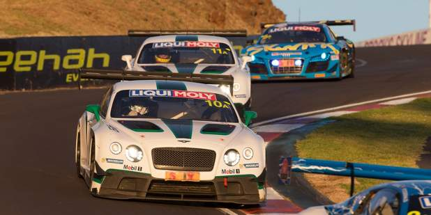 Front view of Bentley Motorsport Continental GT3 cars driving on the race track at Bathurst | Bentley Motors