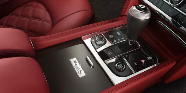 Limited edition signature badging next to the gearshift of a Bentley Mulsanne Majestic interior | Bentley Motors
