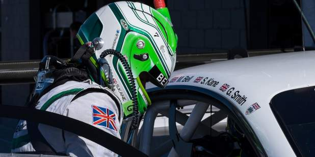Racing driver with green and white helmet getting into a Bentley Continental GT3 | Bentley Motors