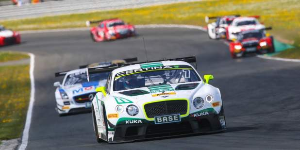 Front view of a Bentley Motorsports car on a race track course at ADAC GT Masters | Bentley Motors
