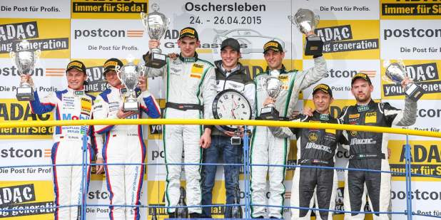 Bentley team HTP celebrating their Adac win with the runner-ups at the podium| Bentley Motors