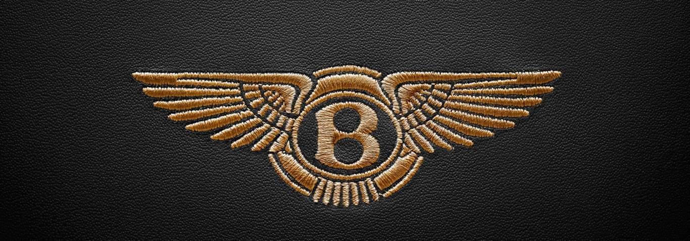 Centenary Spec Bentley Headrest Emblem close up 1920x670.jpg