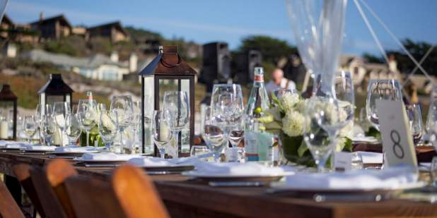 An elegantly arranged table outdoors decorated with crystal tableware and flowers | Bentley Motors